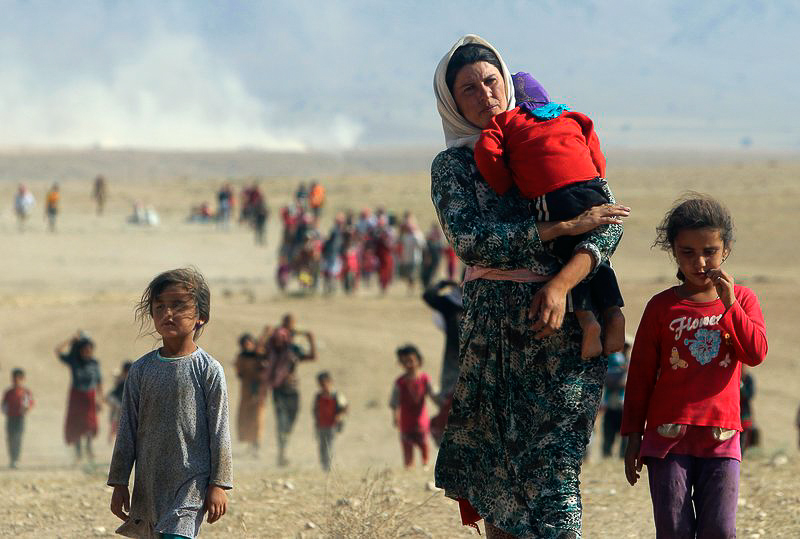 Fig. 13 - Yazidi in fuga (http://time.com/4678246/canada-yezidi-refugees-islamic-state/)