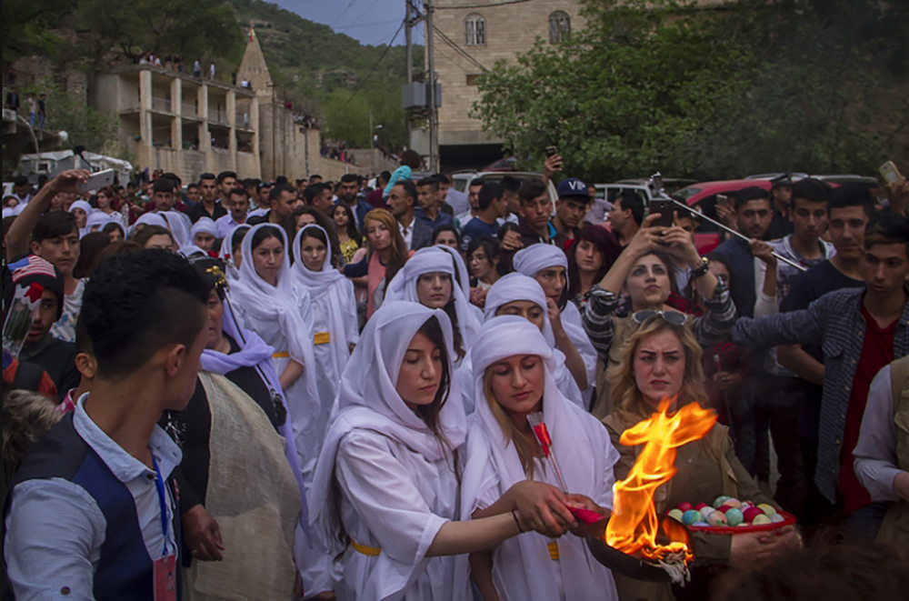 Fig. 27 - New Year celebration in Lalish (http://www.ezidipress.com/en/hope-brings-unity-yezidis-new-year/)